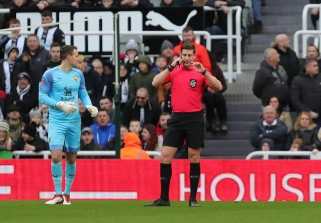 Referee Robert Jones gets confirmation via the VAR not to award Newcastle United a penalty in their Emirates FA Cup tie with Oxford United in January   Picture: Richard Parkes