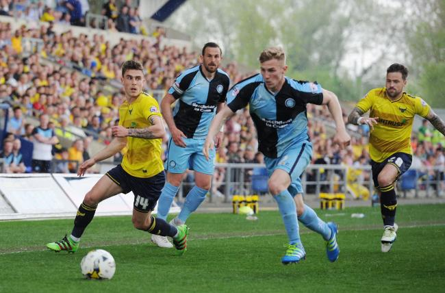 Josh Ruffels, left, in action during Oxford United's last promotion clash with Wycombe Wanderers, in May 2016   Picture: Jon Lewis