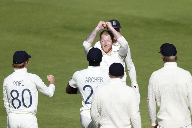 Ben Stokes celebrates taking the wicket of West Indies' Jason Holder