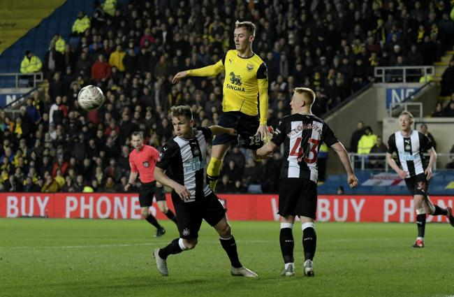 Mark Sykes climbs above two Newcastle United players in Oxford United's FA Cup fourth round replay in February  Picture: David Fleming