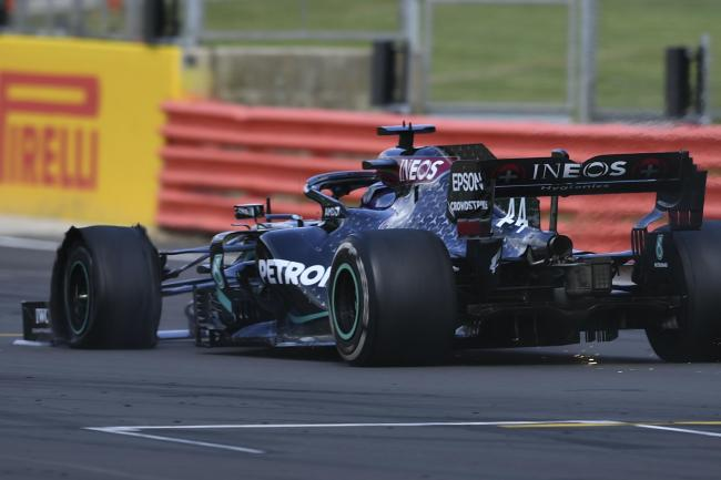 Lewis Hamlton won the British Grand Prix despite suffering a puncture.