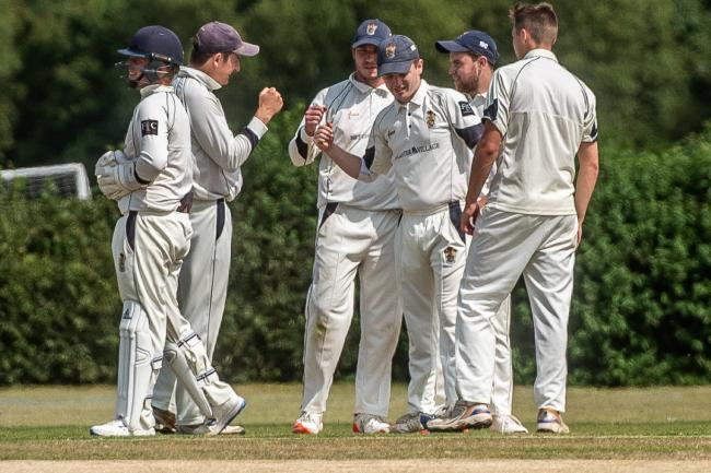 Adam Stapleford-Jones is congratulated after taking a catch for Bicester & North Oxford      Pictures: Richard Cave