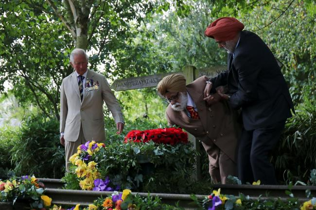 Charles with Second World War veterans