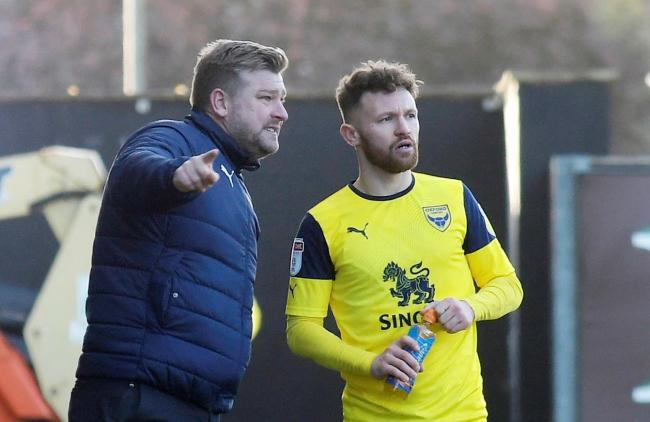Oxford United boss Karl Robinson (left) is looking for another option to Matty Taylor up front in the squad   Picture: David Fleming