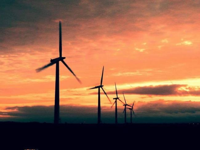 The winter solstice sunrise over the wind turbines at Watchfield by Caoimhin Stares.