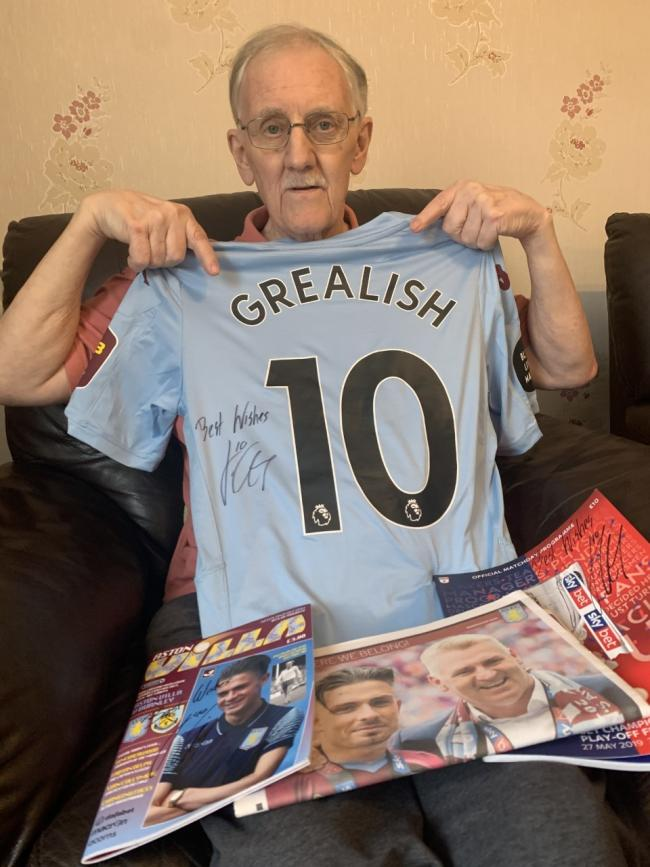 David Quainton with his signed shirt, sent to him by Aston Villa player Jack Grealish