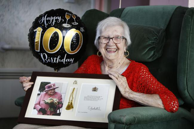 Mrs McHale celebrates her 100th birthday at her flat in Plowman Tower yesterday. 		              Picture: Ed Nix