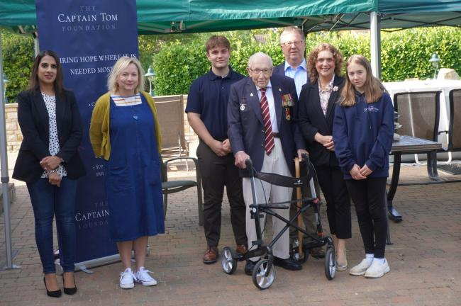 From left. Nadia Slatch and Clare Periton with Captain Sir Tom Moore and his family at the foundation launch