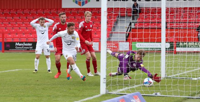 Matty Taylor scores his second goal and Oxford United's fourth at Accrington Stanley   Picture: Richard Parkes