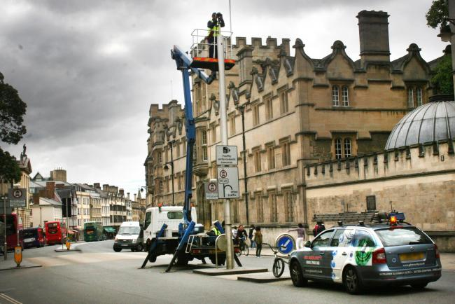Oxford's High Street Bus Gate camera, being maintained. Picture taken in 2015