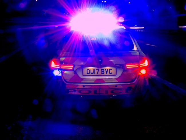 File picture of police car in the dark