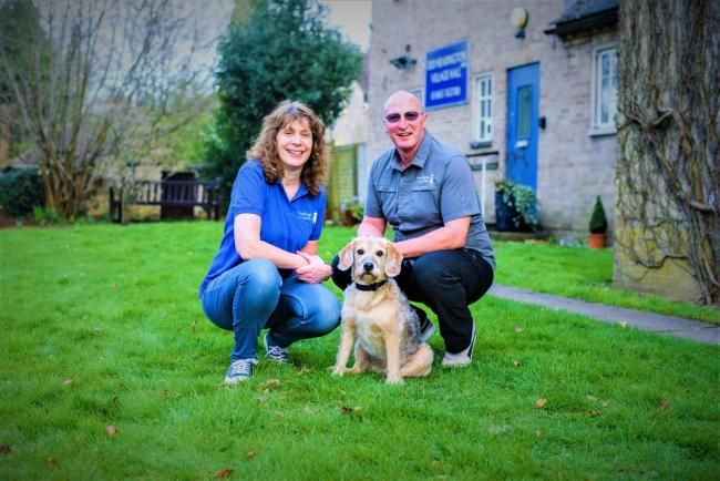 Helen & Martin Stroudley, owner of Headington Dog Training, with their dog Ralph. Picture Bananapie
