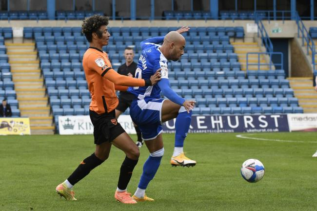 Oxford United's Sean Clare holds up Gillingham's Jordan Graham   Picture: David Fleming