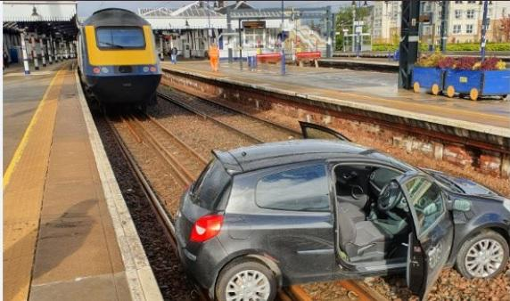 This black car ended up on the track at a railway station in Scotland. Pic: Network Rail