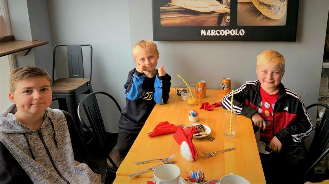 Kids enjoying a free meal at Marcopolo Bakery, Wallingford Street, Wantage.