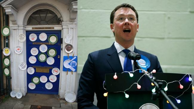 Paper plates stuck to the door of Witney MP Robert Courts following his decision to vote against extending free school meals