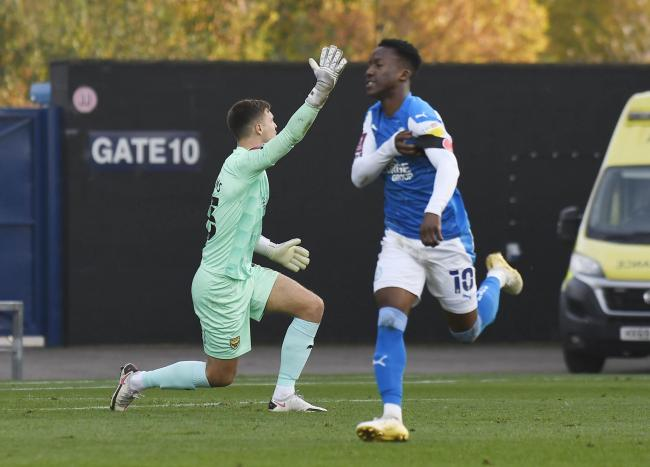 Siriki Dembele celebrates putting Peterborough United in front, as Oxford United goalkeeper Jack Stevens appeals for offside   Picture: David Fleming