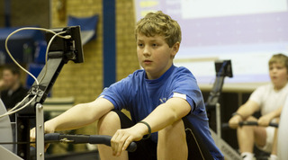 n BIG EFFORT: Hinksey's David Myatt helped his team to third place in the South of England Indoor Rowing Championships at Wheatley Park Sports Centre 	  Picture: Rob Judges