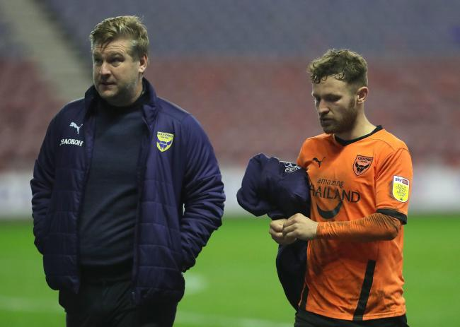 Karl Robinson with Matty Taylor at the final whistle Picture: Richard Parkes