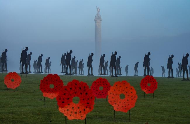 Silhouetted figures of soldiers to commemorate Remembrance Sunday at Blenheim Palace. Picture: Pete Seaward
