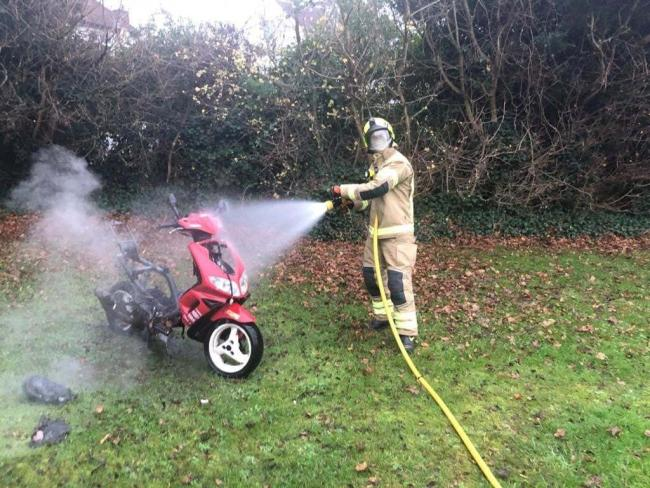Abandoned scooter in Headington on fire