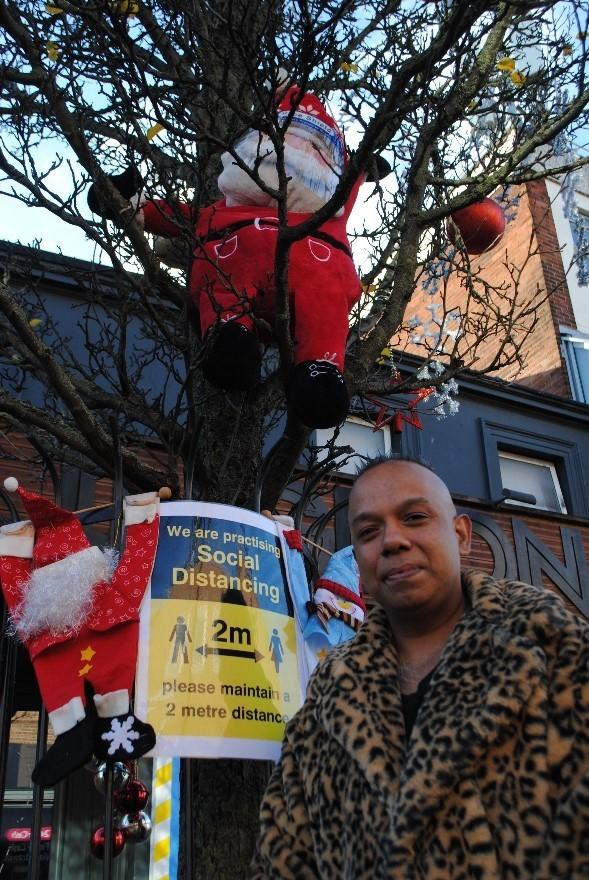 Amir Ali with the Christmas tree in Cowley Road