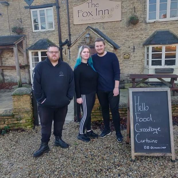 Oxford Mail: Alex Fletcher, Lauren Eames and David Moore outside The Fox Inn, Middle Barton