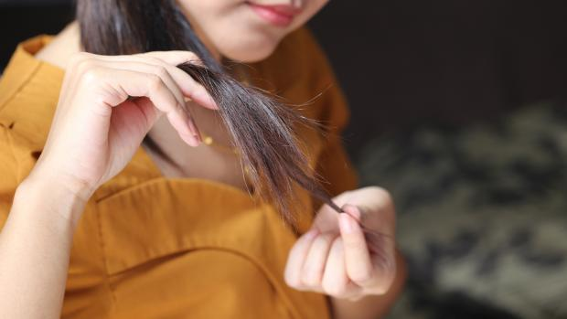 Oxford Mail: Sleeping on wet hair can lead to breakage and split ends. Credit: Getty Images / Monthira Yodtiwong