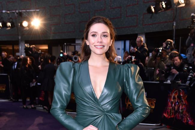 Elizabeth Olsen smiles at the camera