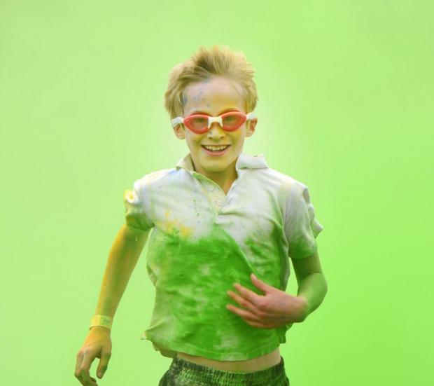 Oxford Mail: A youngster joins in the colour run at Cutteslowe Park