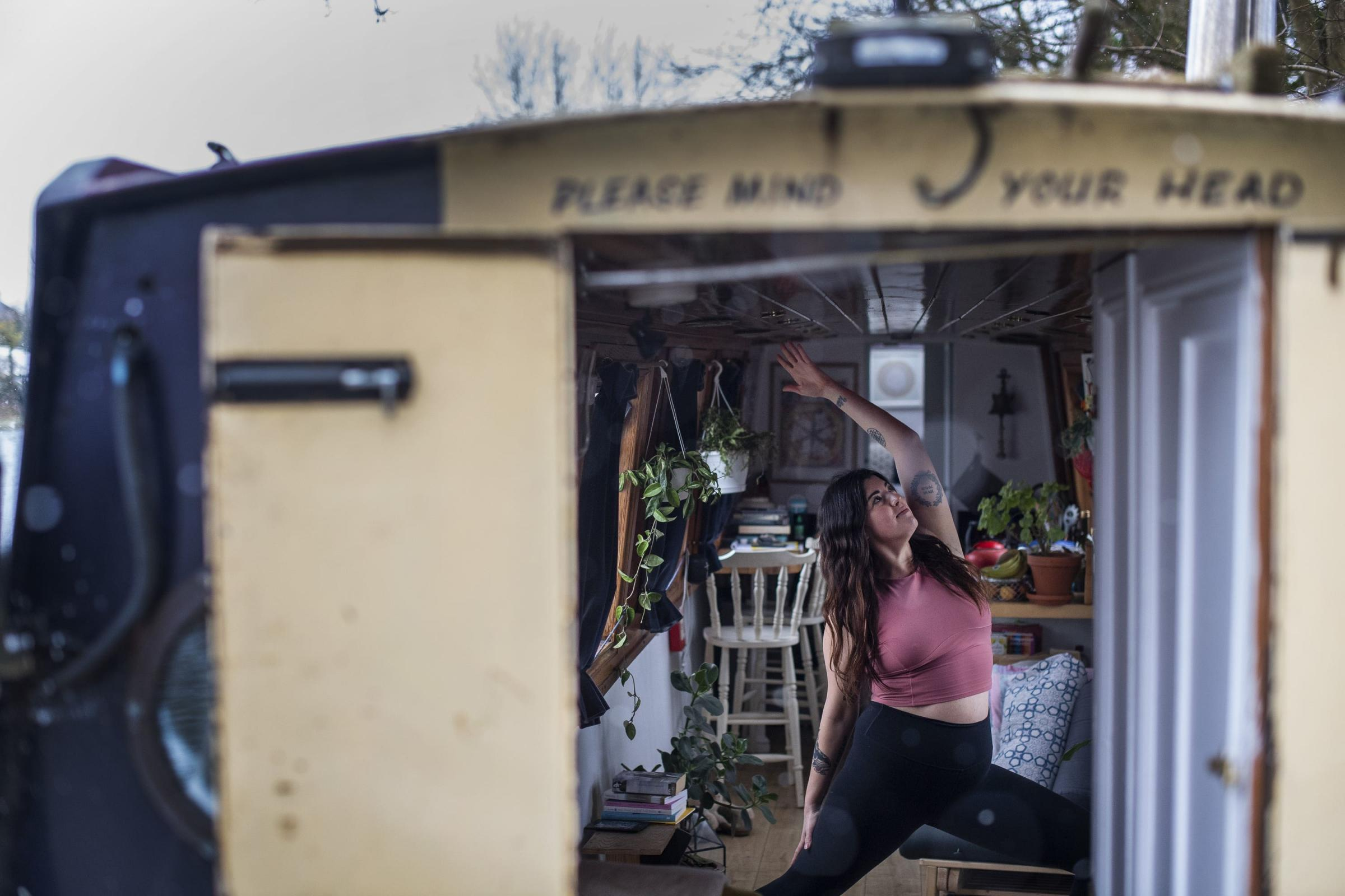 Harriet McAtee on her Oxford narrowboat. Picture: Victoria Jones/ PA
