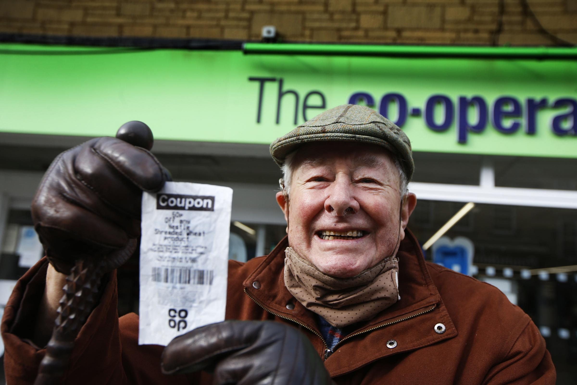 Witney pensioner John Osman collects his 50p from the Co-op after the store refused his voucher. Picture by Ed Nix