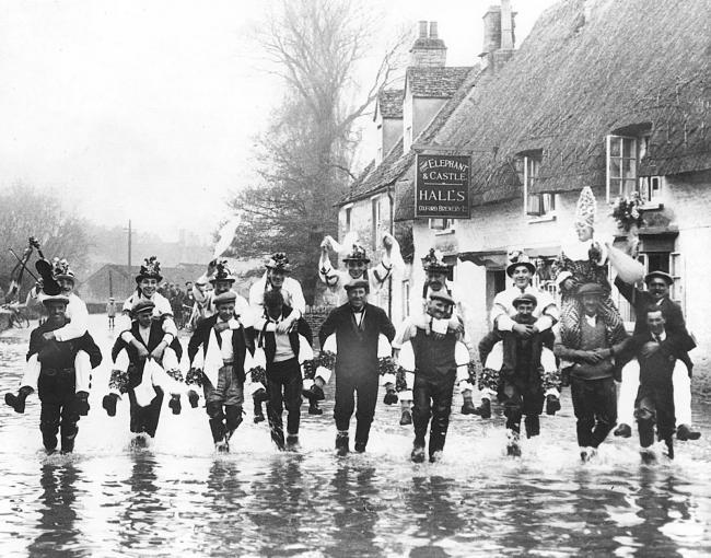 Bampton Morris Men danced through the flood in 1932 in front of the Elephant and Castle pub