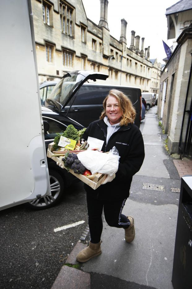 Verity Piggott of Bonners puts deliveries in a van