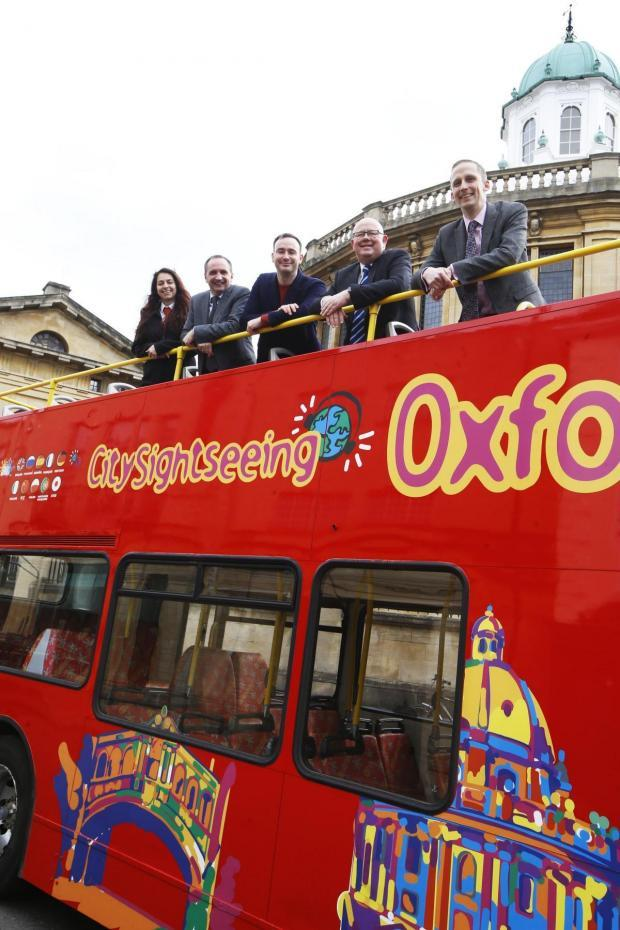 Civic leaders on a City Sightseeing bus in 2020