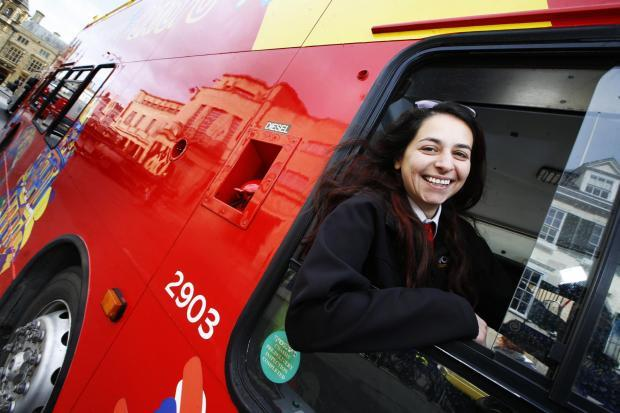 A bus driver working on the City Sightseeing bus