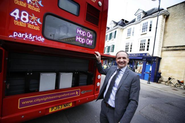 Phil Southall of Oxford Bus Company with an electric City Sightseeing bus