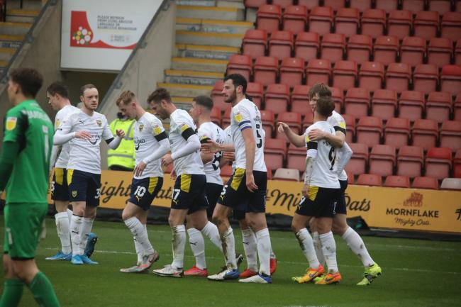 Oxford United return to the centre circle after Elliott Moore's goal at Crewe Picture: Darrell Fisher