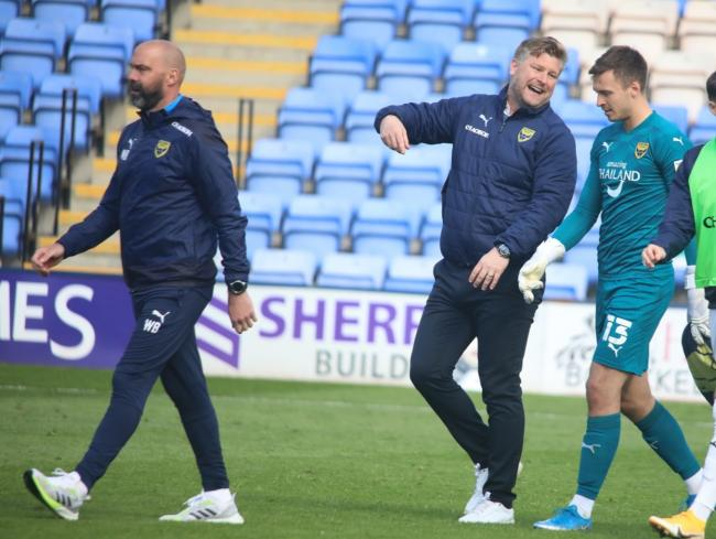 Karl Robinson speaks to Jack Stevens after Oxford United's win at Shrewsbury Town Picture: Darrell Fisher