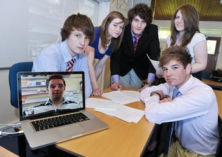 Chris Orr gives his lesson to pupils at Sibford School via the Internet from Spain