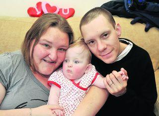 Isabel MacIntyre with her mum Jolene and dad Iain