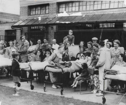 Clowns entertain patients and visitors at the Wingfield fete at Headington in 1951