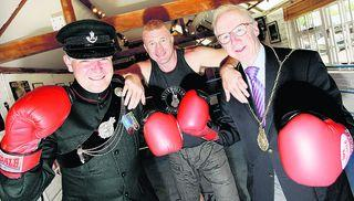 South Moreton Boxing Club head coach John Houston, centre, with Lt Col Simon Hill, left, and the Mayor of Wallingford, Bernard Stone