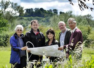 Sally Ainslie, left, Steve Thompson, Lorraine Lindsay-Gale, Graham Keevill and Roger Ainslie study new archaeological data about the discoveries on the site near Dorchester