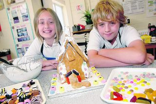 Hollie Parry and Callum Martin, 12, with a Hansel and Gretel-style gingerbread house
