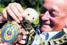 Bicester mayor Richard Mould with a baby ferret at Yarnton Nurseries to promote ferret racing at Bicester Carnival