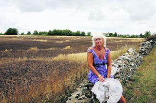 Karen Evins with the wrecked crop of barley