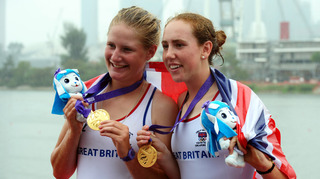 Georgia Howard-Merrill (left) and Fiona Gammond cannot hide their delight at receiving their gold medals at the Singapore 2010 Youth Olympic Games