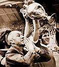 Oxford Mail: BILL SHANKLY: Liverpool captain Emlyn Hughes holds the aloft the League Cup with the manager at his side.