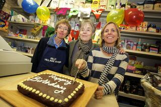 Volunteers, from left, Maralynn Smith, Henrietta Leyser and Emily Cohen with birthday cake